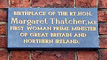 "photograph of plaque reading ""Birth place of the Rt.Hon. Margaret Thatcher, M.P. First woman prime minister of Great Britain and Northern Ireland"""