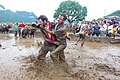 Playing in mud in a rice field in Nepal.jpg