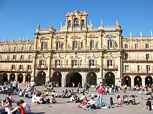 Plaza Mayor, Salamanca - The front of the plaza, showing the clock tower in the background and social gatherings in the front