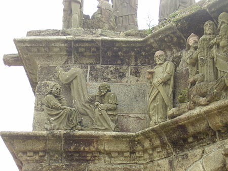 In this view of the north face of the Pleyben calvary we see Jesus praying in the Garden of Olives surrounded by two sleeping apostles. We then see St Peter with his sword looking down to his left at the scene depicting Jesus' arrest.