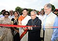 Pranab Mukherjee and the Union Minister for Human Resource Development, Smt. Smriti Irani, during the inauguration of various activities - Inauguration of Cricket Practice Pitch, Meeting Football Team.jpg
