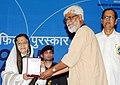 Pratibha Devisingh Patil presenting the Rajat Kamal Award to Shri Megnath for the Best Promotional Film (Ek Ropa Dhan), at the 58th National Film Awards function.jpg