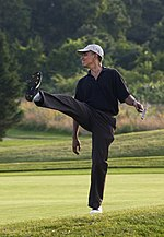 President Barack Obama puts a little body English on his shot during a round of golf at Farm Neck golf course during his vacation on Martha's Vineyard