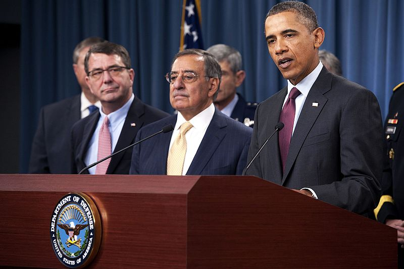 President of the United States Barrack Obama delivers a press brief along with Secretary of Defense Leon Panetta and General Martin Dempsey.jpg