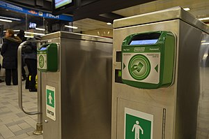Presto card - Presto card readers at Finch subway station. Legacy turnstile faregates like these are being removed and replaced with new paddle-doored fare gates, already in use in many subway stations across the TTC subway network.