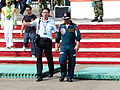 ROCA Airborne Training Center Command Colonel Lo and Photographer Walking to Ground for Interview 20131012.jpg