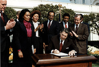 Martin Luther King Jr. Day - Ronald Reagan and Coretta Scott King at the Martin Luther King Jr. Day signing ceremony.