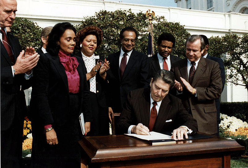 President Ronald Reagan signs the bill commemorating Martin Luther King Jr.'s birthday as a national holiday on Nov. 2, 1983 in the White House rose garden.