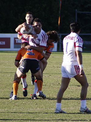 Redcliffe Dolphins - Redcliffe Dolphins tackled by Easts at Langlands Park in 2011.