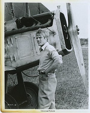 The Great Waldo Pepper - Redford in The Great Waldo Pepper, standing by the nose of a Standard J-1 biplane used in the movie.