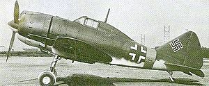 Reggiane Re.2002 - A Reggiane Re 2002 at Taliedo in early 1945, bearing German markings in preparation for delivery to a German Luftwaffe Schlachtgruppe.
