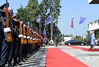 Presidential Palace, Zagreb - Croatian President Kolinda Grabar-Kitarović and President of Israel Reuven Rivlin saluting an Honor Guard Battalion in front of the palace, 2018.