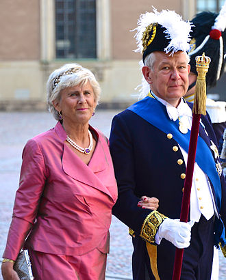 Marshal of the Realm (Sweden) - Svante Lindqvist, with wife Catharina, on the way to the Royal Chapel in Stockholm before the wedding of Princess Madeleine and Christopher O'Neill on June 8, 2013.