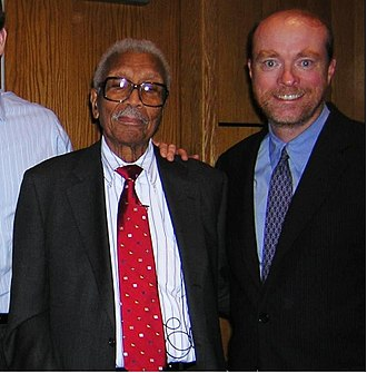 Robert L. Carter - Carter being awarded honorary degree by Fordham Law School, dean William Treanor.  November 2004