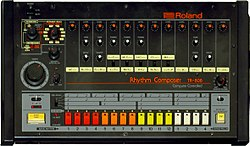 The TR-808 front panel: a black box with rows of colored buttons and dials.