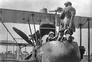 Royal Aircraft Factory F.E.2 - An F.E.2d observer demonstrating the use of the rear-firing Lewis gun, which required him to stand on the rim of his cockpit. Note the camera, and the (non-standard) extra Lewis gun for the pilot.