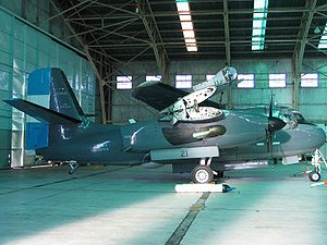 Grumman S-2 Tracker - Argentine S-2T Turbo Tracker in hangar with wings folded.