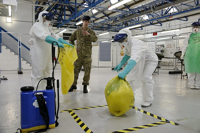 ملف:Safely disposing contaminated waste in the fight against Ebola (15649902677).jpg