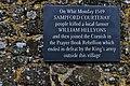 Sampford Courtenay village- Prayer Book Rebellion plaque (geograph 4951678).jpg
