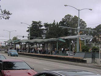 19th Avenue (San Francisco) - The intersection of 19th Avenue and Holloway Avenue with a Muni Metro station in the background