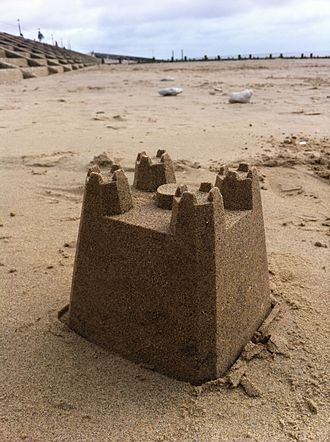 Sand art and play - A simple sandcastle built  from a shaped plastic bucket