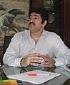 Sandeep Marwah at desk crop.jpg