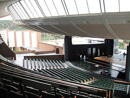 The interior of the Crosby Theatre at the Santa Fe Opera, viewed from the mezzanine in 2006 Santa Fe Opera interior view from section 10.jpg