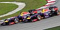Sebastian Vettel overtaking Mark Webber 2013 Malaysia 2.jpg