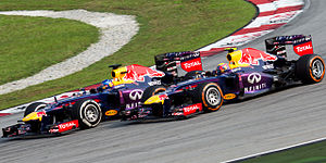 2013 Malaysian Grand Prix - Vettel's controversial pass during the race. Vettel (left) overtook teammate Mark Webber (right) despite team orders telling him to hold position behind the Australian.