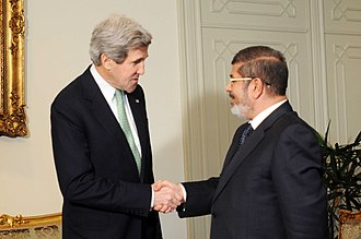 Muslim Brotherhood in Egypt - U.S. Secretary of State John Kerry meets with Egyptian President Mohamed Morsi, March 2013