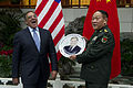 Secretary of Defense Leon E. Panetta laughs as he is presented with a plate commemorating his visit to China by Chinese Minister of National Defense Gen. Liang Guanglie after an official dinner in Beijing, Chin 120918-D-BW835-634.jpg