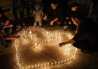Mourning of Muharram - Muslims gather for the Ashura mourning and lighting candles in Tehran, Iran.