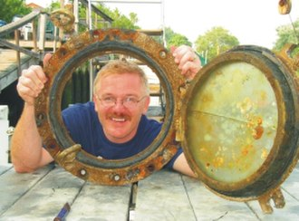 Wreck diving - Diver with porthole recovered from a shipwreck in New York's Wreck Alley