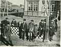 Siberian peasants watching a train at a station, (1902).jpg