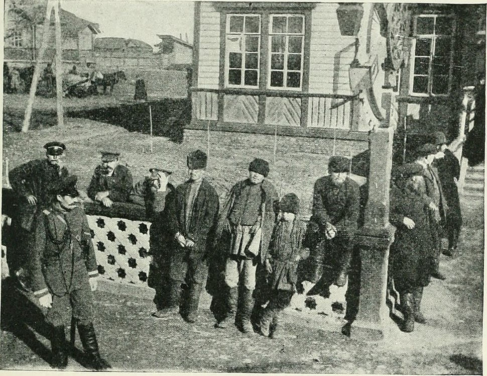 Siberian peasants watching a train at a station, (1902)