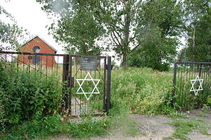 Avrohom Bornsztain - Jewish cemetery in Sochaczew, with the restored, red-brick ohel in background.