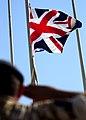 Soldier Salutes Union Jack Flag MOD 45151534.jpg