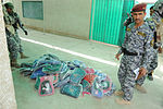 Soldiers, Iraqi national policemen distribute school supplies in Baghdad DVIDS157185.jpg