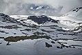 Some Hurrungane peaks looming above Grånosi, Oppland, Norway in 2013 June.jpg