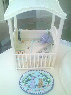 Baby shower - Baby shower cake (note that the coverlet is turned back waiting for the new baby)
