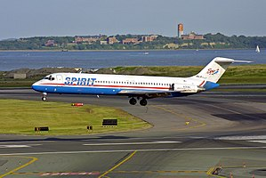 Spirit Airlines - Spirit DC-9-40 number N130NK, in old livery, lands at Logan International Airport in Boston, Massachusetts.