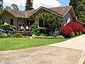 Starr-120510-5689-Nandina domestica-habit with Kim Donna and Sterling on porch-Ka Hale Olinda-Maui (25116083726).jpg