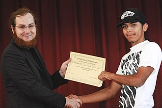 Academic certificate - A student being awarded a certificate in an American high school.