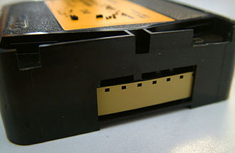 Super 8 film - A Super 8 film cartridge with a close-up of the film