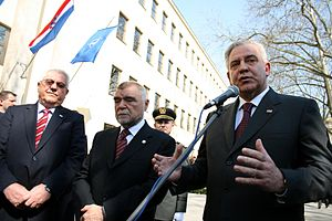 Ivo Sanader - Speaker of Croatian Parliament Luka Bebić (left) and President of Croatia Stjepan Mesić (center) with Ivo Sanader at NATO flag-raising ceremony in front of building of Ministry of Defence of Croatia on 7 April 2009