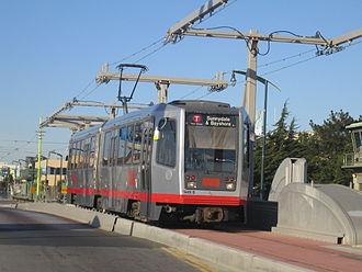Destination sign - A SF Muni T Third Street light rail train with a Mylar roll headsign
