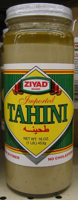 Tahini - Tahini in a jar with natural oil separation visible at the top