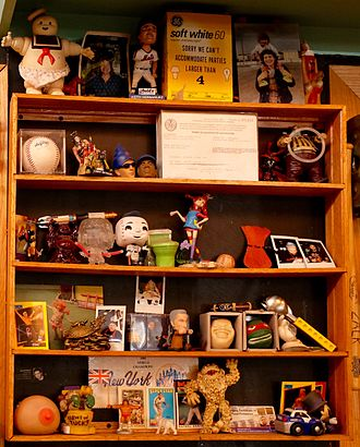 Tchotchke - A cabinet of tchotchkes and memorabilia behind the counter at Shopsin's in the Essex Street Market in New York City