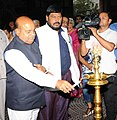 """Thaawar Chand Gehlot lighting the lamp to inaugurate the documentary photo exhibition """"The Paths We Walk"""", organised by the National Trust under Ministry of Social Justice & Empowerment, in New Delhi.jpg"""