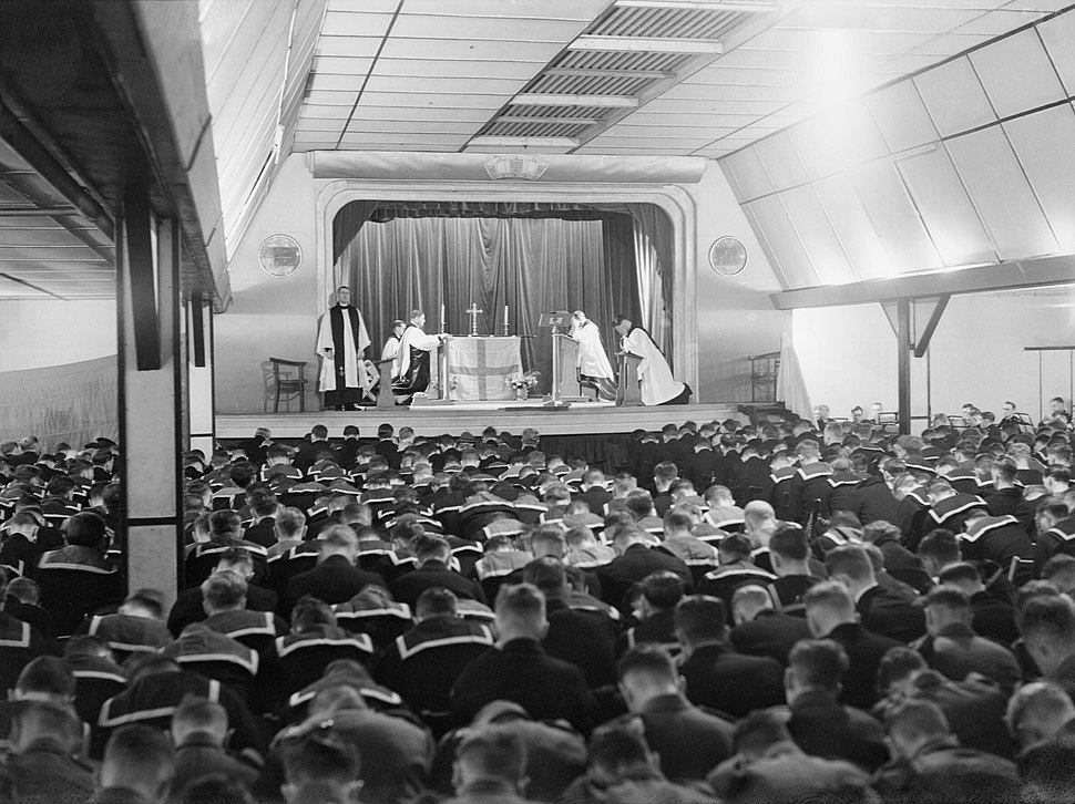 The Archbishop of Canterbury conducts a service in the cinema at Flotta on Orkney during his visit to the Home Fleet at Scapa Flow, 6 September 1942. A11549